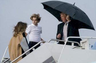 482CAD4700000578-5273011-Also_not_pictured_under_the_umbrella_was_wife_Melania_47_Trump_k-a-4_1516108213414